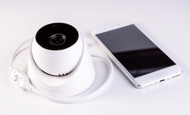 Sistema de seguridad con cámara de cctv. video de seguridad en una mesa. bueno para empresa de ingeniería de servicios de seguridad