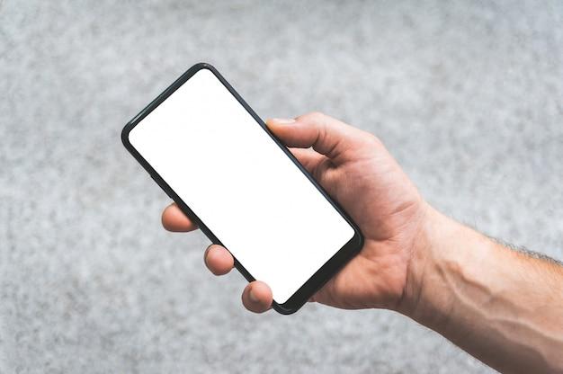 Smartphone en mano