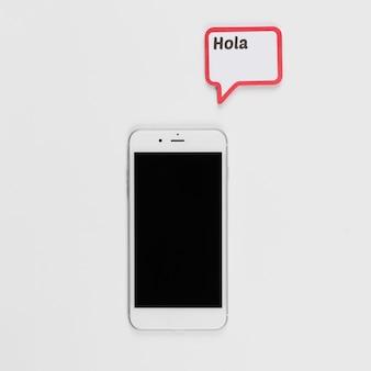Smartphone y marco con inscripción hola.