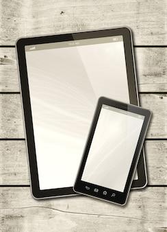 Smartphone y tableta digital sobre una mesa de madera blanca