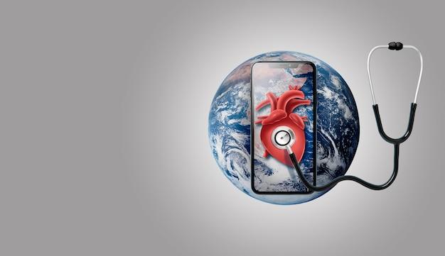 Smartphone en la tierra con estetoscopio en un corazón
