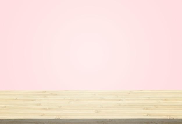La sobremesa laminada sobre fondo rosa pastel puede poner o montar sus productos