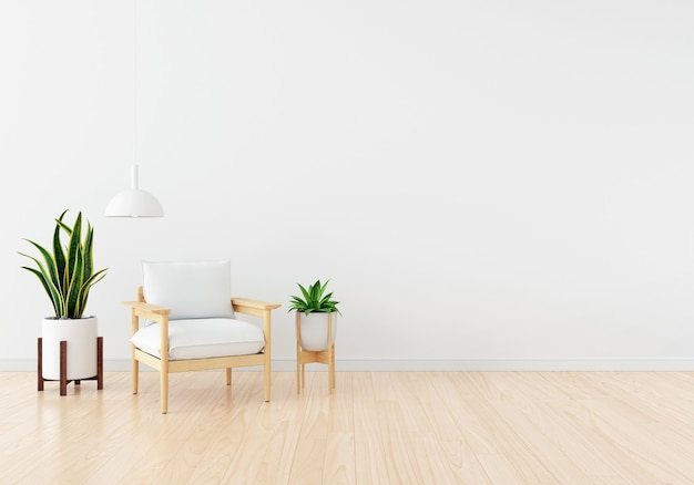Sofá blanco con planta verde en salón