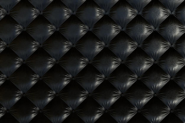 Sofá de color negro con textura.
