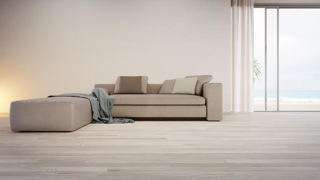 Sofá gris cerca de la pared en blanco en el piso de madera vacío del gran salón en casa moderna o villa de lujo