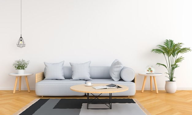 Sofá gris y mesa en salón blanco.