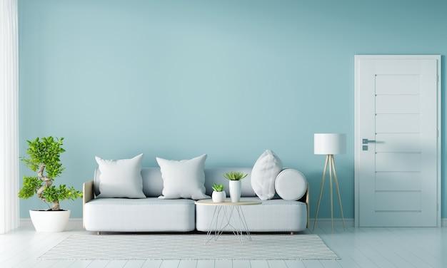 Sofá gris en salón azul con espacio de copia