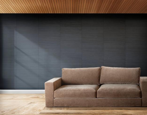 Sofá marrón en una habitación con paredes grises.
