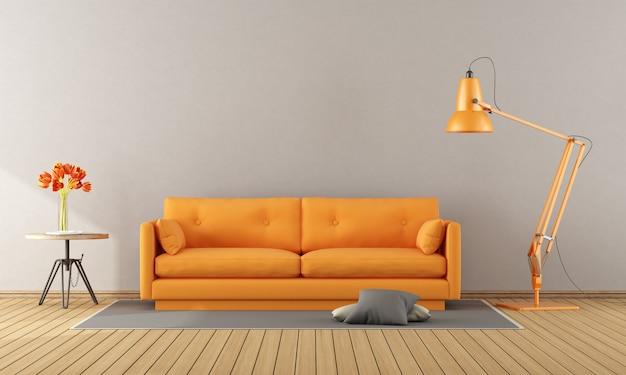 Sofá naranja en una habitación moderna.