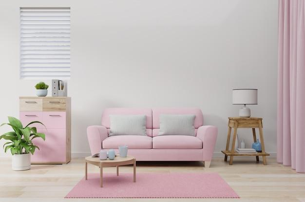 El sofá rosa en la pared de la sala de color blanco.