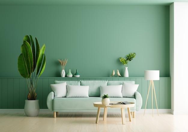 Sofá en salón verde con espacio de copia