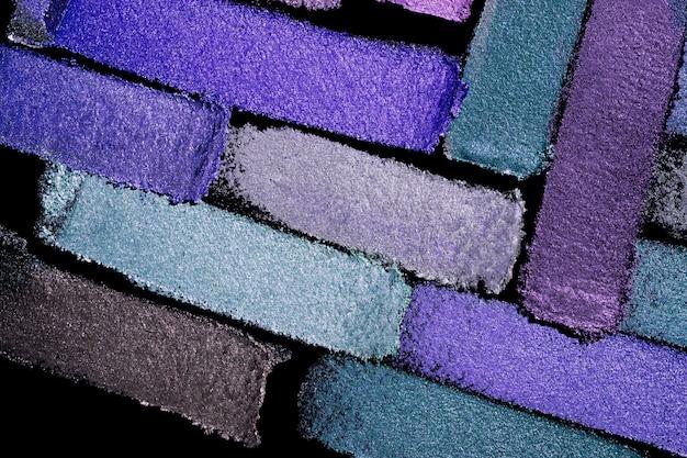 Sombra de ojos brillante mate multicolor paleta gris púrpura textura del fondo