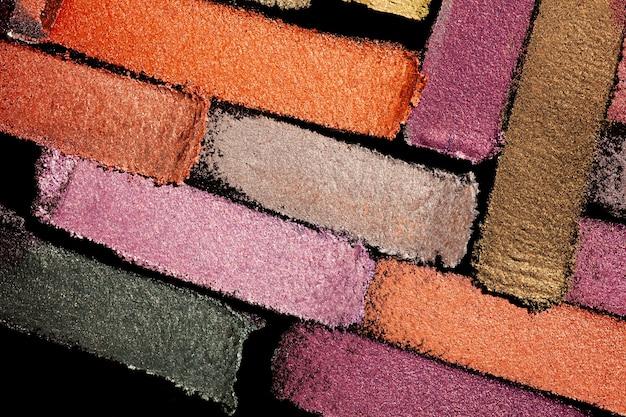 Sombra de ojos brillante mate multicolor paleta rosa naranja púrpura textura de fondo