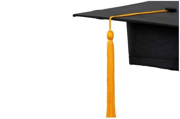 Sombreros negros, borlas doradas de graduados universitarios