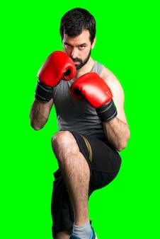 Sportman con guantes de boxeo