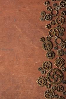 Steampunk engranajes mecánicos engranajes ruedas sobre fondo de madera