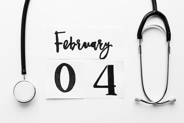 Sthetoscope y fecha del word cancer day
