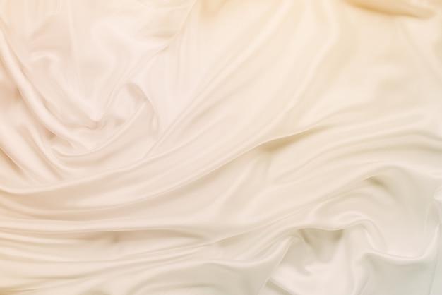 Suave y elegante fondo de boda de seda dorada entonado