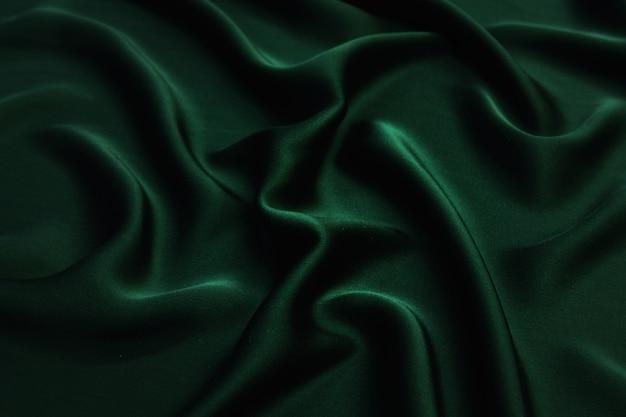 Suave seda verde elegante o textura de tela de satén de lujo