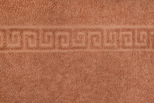 Suave textura perfecta de una toalla con adorno griego