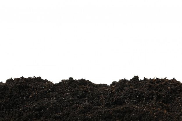 Suelo fértil aislado en blanco aislado. agricultura y jardinería