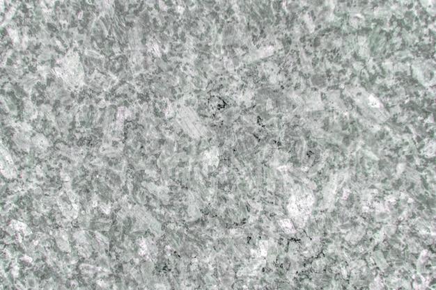 Suelo de mármol gris y blanco.