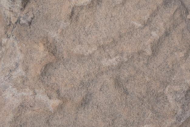 Suelo de piedra marrón con textura.
