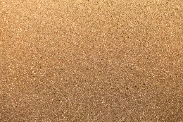 Superficie de brillo dorado con puntos irregulares parpadeantes