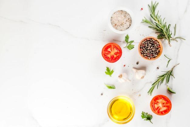 Superficie de cocción, hierbas, sal, especias, aceite de oliva.
