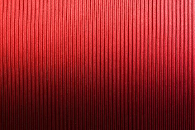 Superficie decorativa de color rojo anaranjado, degradado vertical de textura rayada. arte de papel tapiz. diseño.