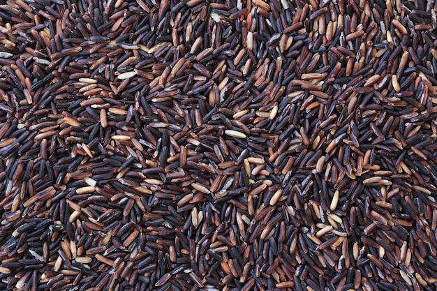 Superficie del fondo marrón del arroz del jazmín.