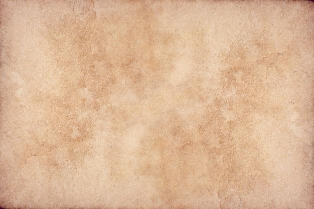 Superficie de grunge de papel marrón viejo. textura de color café líquido abstracto.