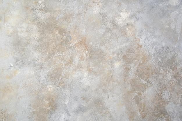 Superficie de hormigón gris con tonos blancos y beige.
