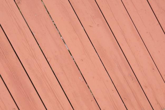 Superficie de madera diagonal de color rosa rosa viejo