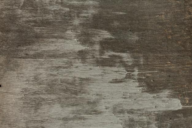 Superficie de madera gruesa con pinceladas