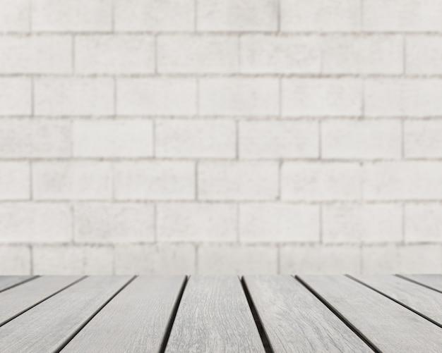 Superficie de mesa mirando hacia pared de ladrillo gris