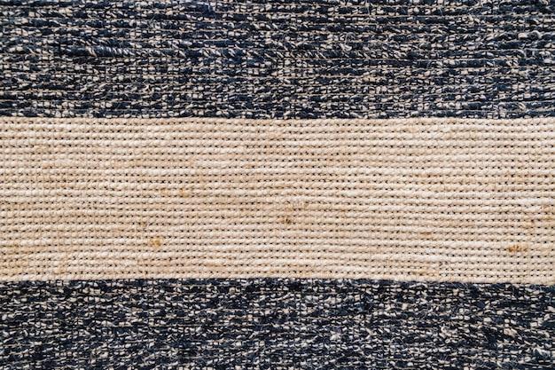 Superficie mezclada tejida de sisal natural, textura y fondo de color