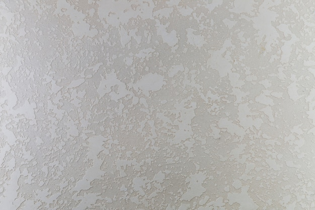 Superficie de muro de hormigón con manchas rugosas