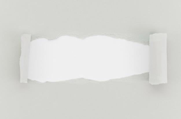 Superficie de papel rasgado gris