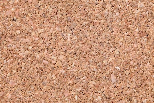 Superficie plana con textura de corcho marrón claro natural.