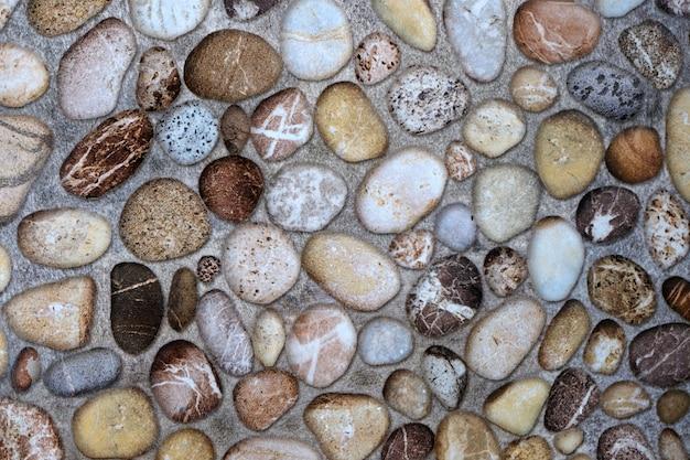 Superficie de roca de piedra con textura sobre fondo de pared de cemento