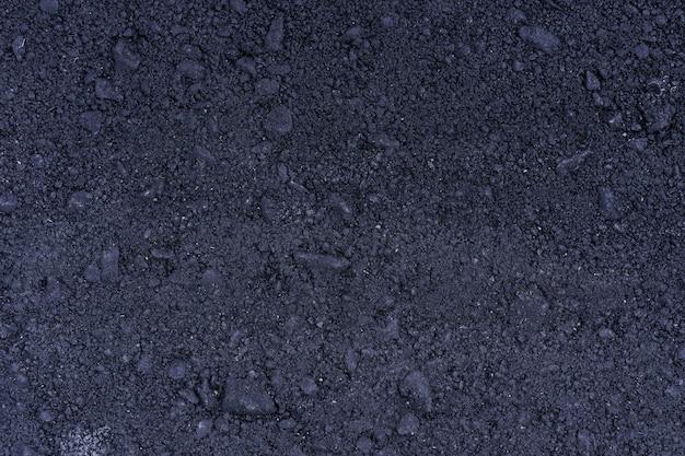 Superficie rugosa del grunge de asfalto, camino granulado gris asfaltado, fondo de textura, vista superior