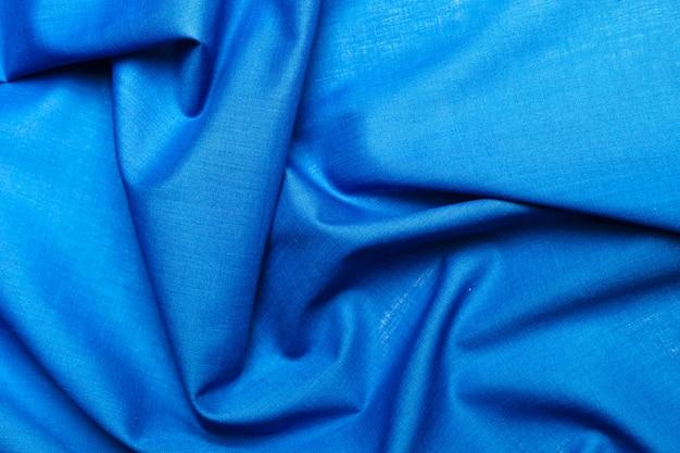 Superficie de tela de seda azul