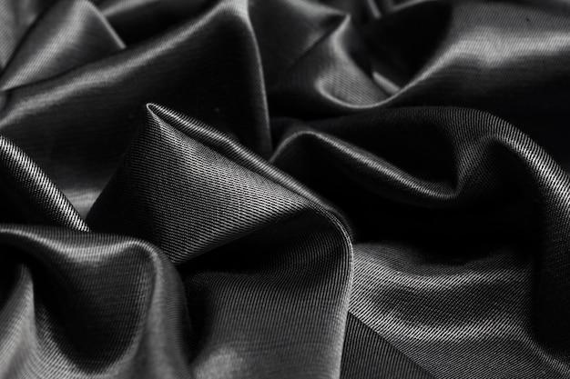 Superficie de tela de seda negro