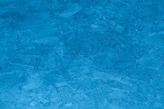 La superficie de la textura del fondo presionó el azul de madera.