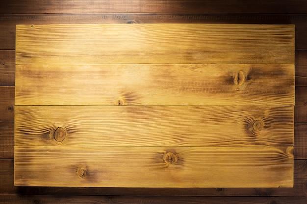 Superficie de textura de fondo de tablón de tablero de madera