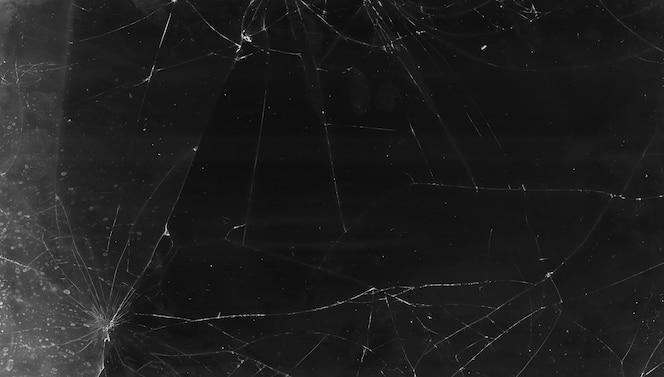 Superposición agrietada. textura de vidrio roto. pantalla de tableta angustiada rota en negro con polvo, rasguños, huellas dactilares, manchas, efecto de ruido de grano para editor de fotos.