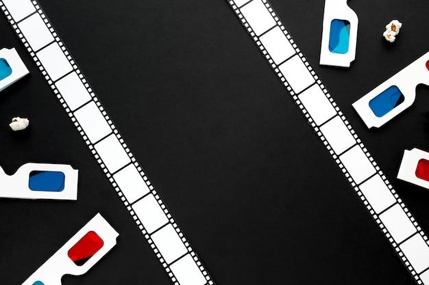 Surtido de elementos de cine sobre fondo negro con espacio de copia
