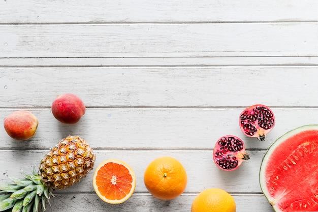Surtido de fondo tropical de frutas cítricas
