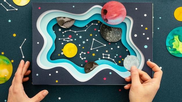 Surtido de planetas de papel creativo de vista superior